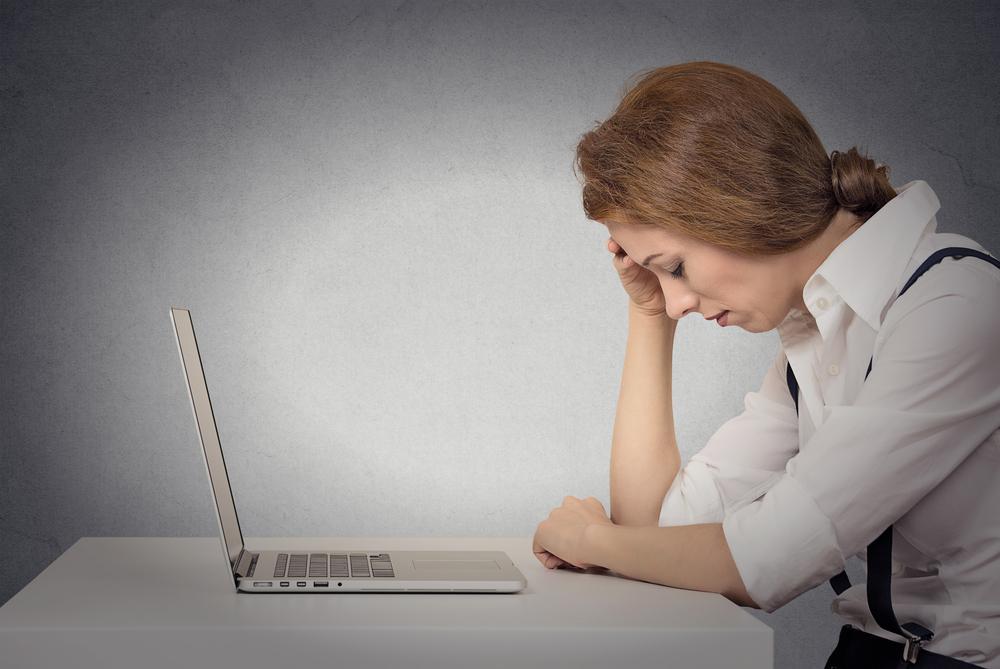 worried woman computer