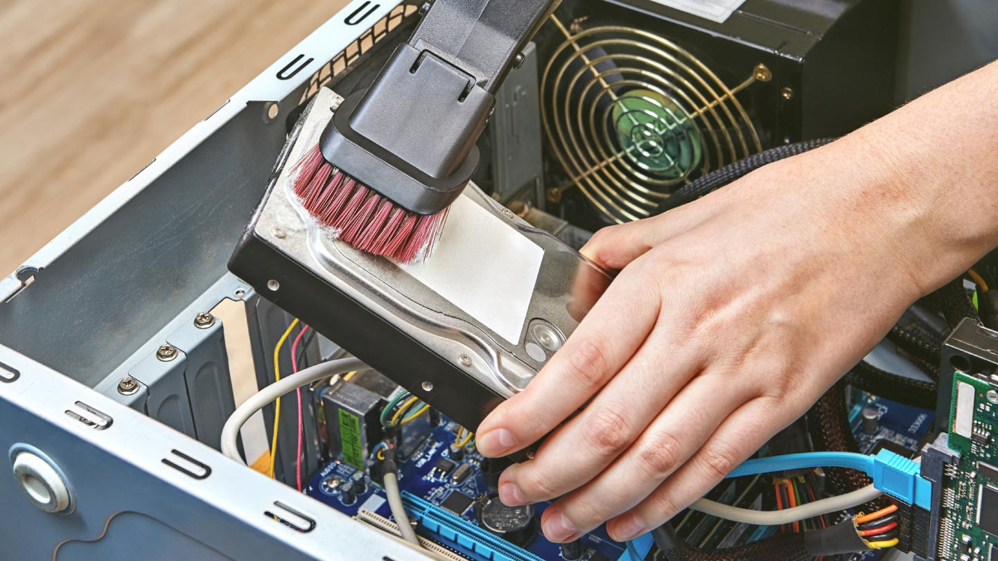 photo of someone cleaning their computer