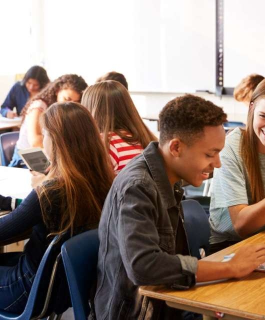 Teen students using edtech in a classroom