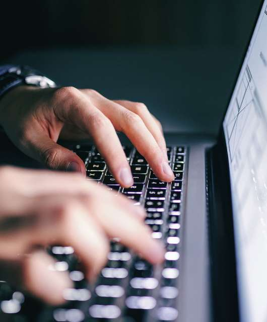hands-typing-on-laptop-keyboard